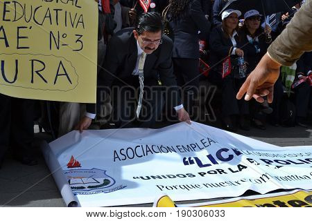 QUITO, ECUADOR - MAY 07, 2017: An unidentified people protest to get decent work with designation and not contract by Ecuadorian government.