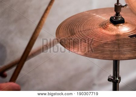 The Drum Stick Hit On The Crash Cymbal In The Low Key Background