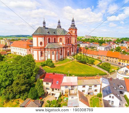 Church of The Assumption (1775) in small town Prestice. Architecture from above. Rare baroque monument in Czech Republic, Central Europe.