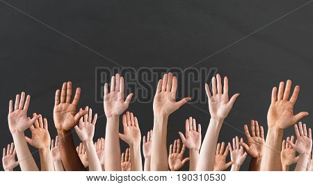 Crowd Raising Hands High Up On Gray Background