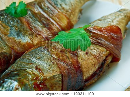 Trout Wrapped In Bacon with Rosemary. close up