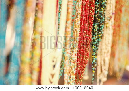 OTAVALO, ECUADOR - MAY 17, 2017: Beautiful andean traditional clothing and handicrafts necklace art, colorful necklace background.