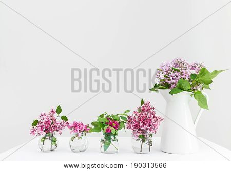 Vases with pink and purple spring flowers. Beautiful floral arrangement.