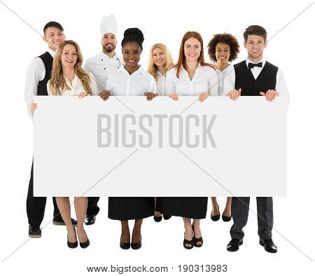 Happy Multiracial Restaurant Staff Holding Long Blank Banner