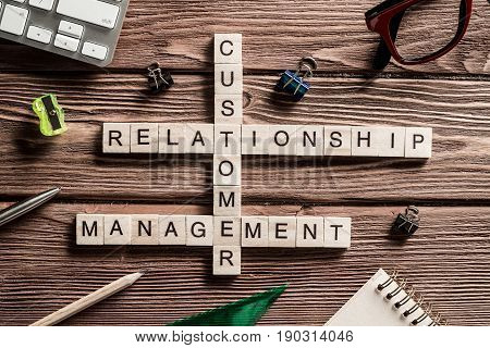 Words of business marketing collected in crossword with wooden cubes