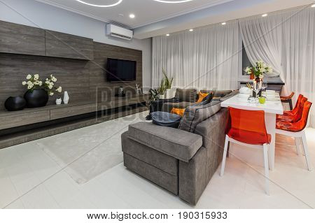 Modern white living room with dining table