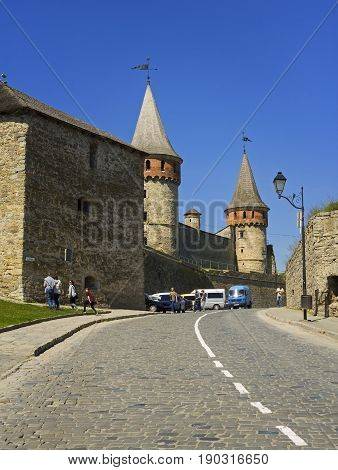 Kamyanets-Podilsky Ukraine - 19 May 2017: Tourists visiting the castle often going by cars.