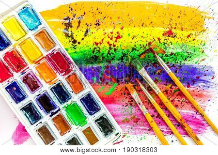 Color oil painting texture with brushes and pallete for bright abstract background
