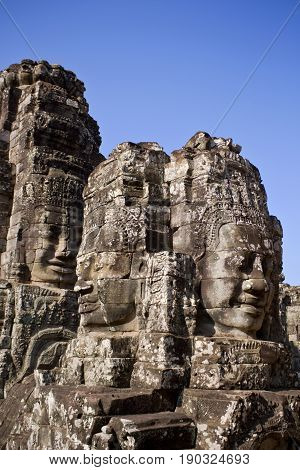 Buddha head towers in Bayon Temple Cambodia.