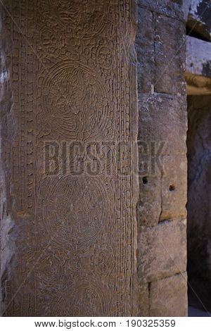 Pillar carving detail in Bayon Temple Cambodia.