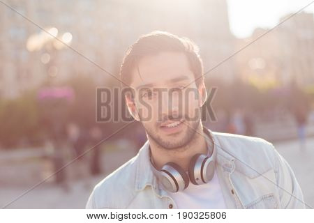 Close Up Of A Young Attractive Brunete Guy, Walking In The City Outdoors,  In Casual Comfortable Out
