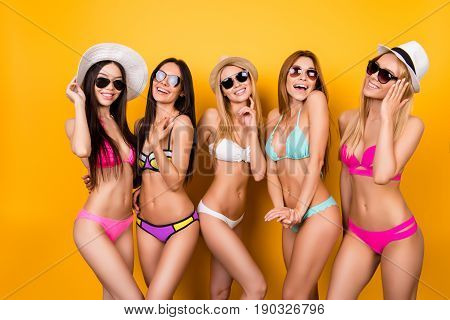 Summer, Joy, Hen Party, Playful Mood. Five Hot Chicks Are Posing In Trendy Swimming Suits And Sungla