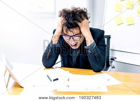 busy and headache person in office and unsuccessful businessman