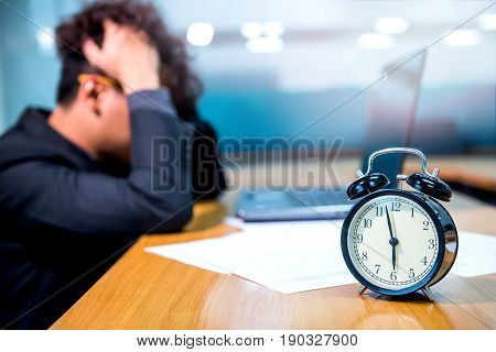 busy and headache person unsuccessful businessman on deadline