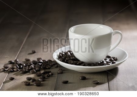 White Cup Of Coffee On Brown Wood Table