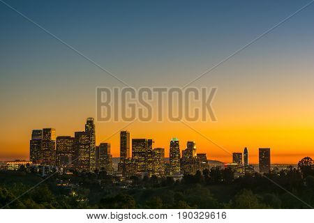 view of the dowtown los angeles lights at sunset from Elysian Park