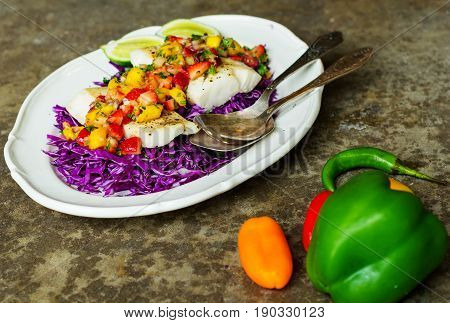 Decontructed Fish Tacos on a bed of cabbage