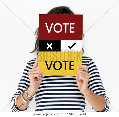 Woman hold vote card cover her face