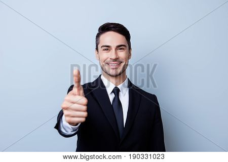 Successful Excited Young Brunete Guy Banker With Bristle In Formal Wear Is Standing Isolated On A Pu