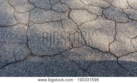 Background of a asphalt texture with cracks