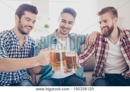 Close Up Portrait Of Three Happy Men Friends, Clinking With Glasses Of Beer, Smiling, Alll Are In Ca