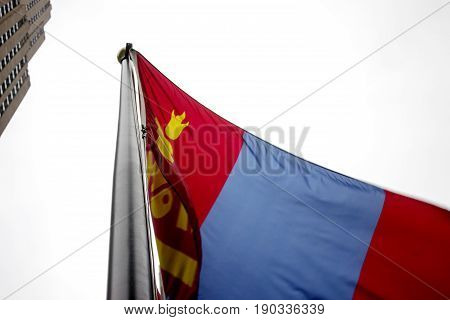 Mongolian flag waving in the air in front of the Rockefeller building