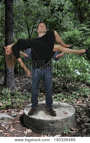 Man Levitating A Woman