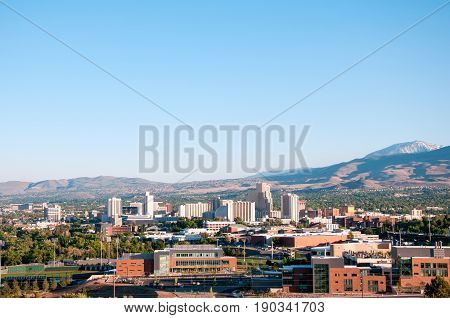 Image of the skyline of Reno Nevada with the University of Nevada Reno in the foreground.