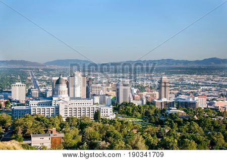 Skyline of Salt Lake City Utah with the Utah State Capitol Building and the historic Mormon Temple