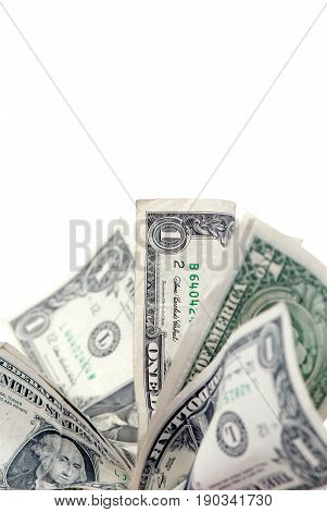 A random fan of dollar bills. Shallow depth of field focus on the dollar bill in the middle of the image.