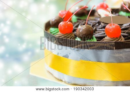 Close Up Chocolate cake with merry christmas xmas style on light effect background.