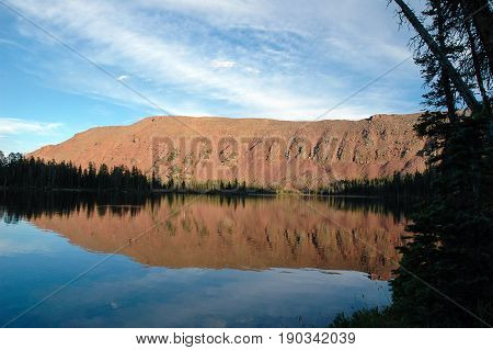 Evening light reflecting from the mountain on Grandaddy Lake in the High Uintas in Utah