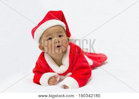 Asian cute new born baby with costume santa merry christmas xmas on white bed background.