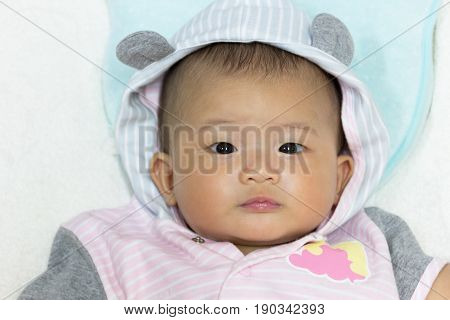 Close Up Asian cute new born baby on white bed.