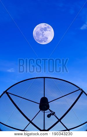 Communication satellite dish on the roof with supermoon night sky background.