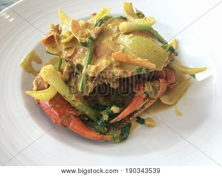 Close up sauteed crab in yellow curry sauce food thai style.