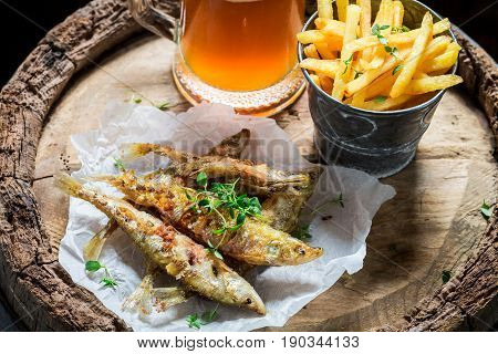 Delicious Roasted Smelt Fish With Cold Beer And Chips