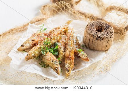 Closeup Of Fresh Roasted Smelt Fish With Herbs And Salt
