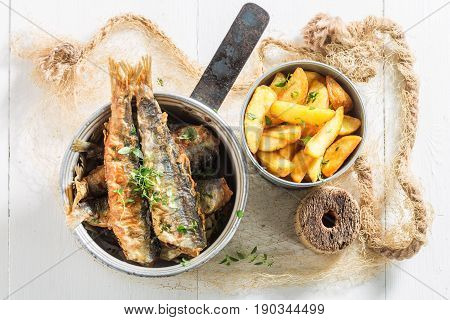 Closeup Of Smelt Fish And Chips With Herbs And Salt