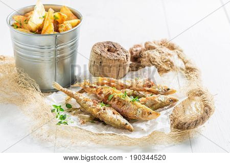 Smelt Fish And Chips With Herbs On White Background