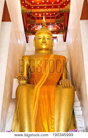 Big golden buddha statue in public Wat Palelaiworaviharn Temple at Suphanburi Thailand.