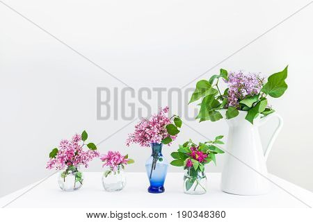 Bouquets of pink and purple spring flowers. Beautiful floral arrangement.