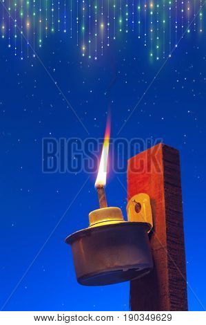 a burning pelita with blue background