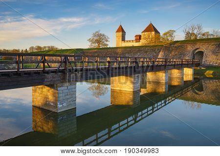 Kuressaare castle with bridge over the moat in beautiful sunrise light. Saaremaa Kuressaare