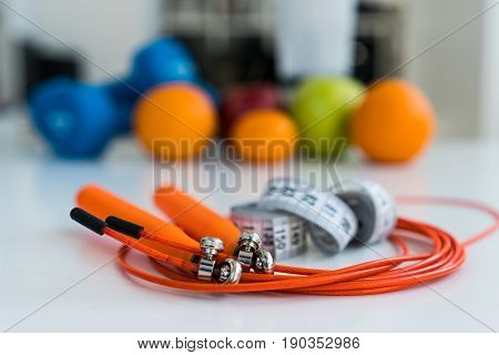 Tape waist meter and skipping rope on a background of fruit. healthy eating concept. healthy lifestyle. Fitness food. sport.