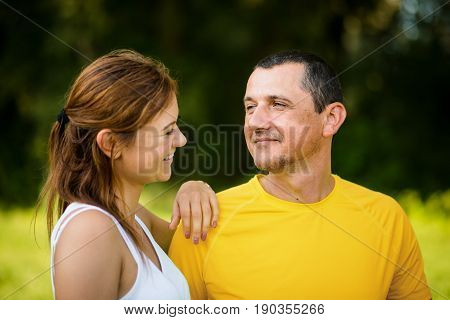 Adult daughter with father spending summer day outside