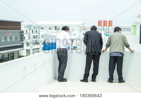 Property and business man concept - Back view off property business man and buyer visit site and copyspace
