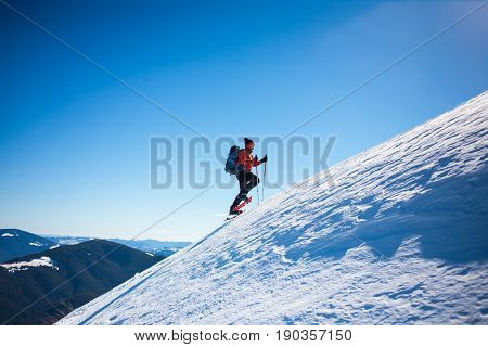 Climber In The Winter Mountains.