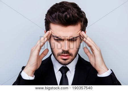 Close Up Photo Of Sad Man In Black Suit Touching His Temples Because Of Suffering From Migraine