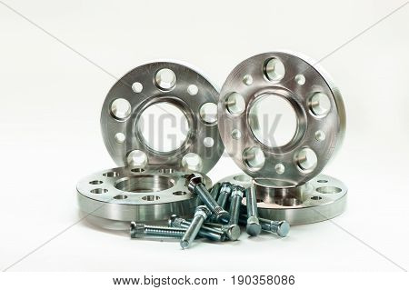 Metal mold of flanges and bolts. CNC milling and lathe industry. Metal engineering. Horizontal indoors closeup image on white background.